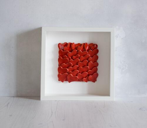 Quadro con cuori rossi in ceramica